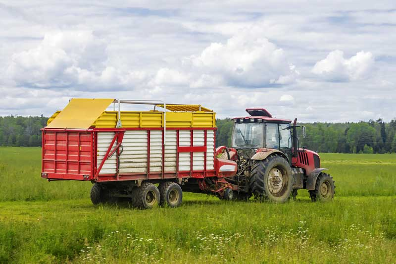 Tractor feeding out trailer needs repair